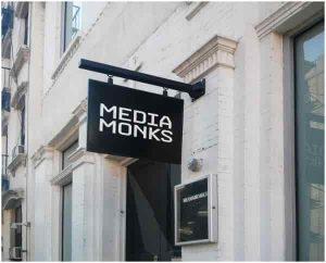 media monks swinging sign