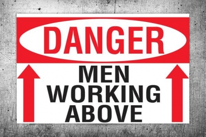 Man Working Above Danger Sign