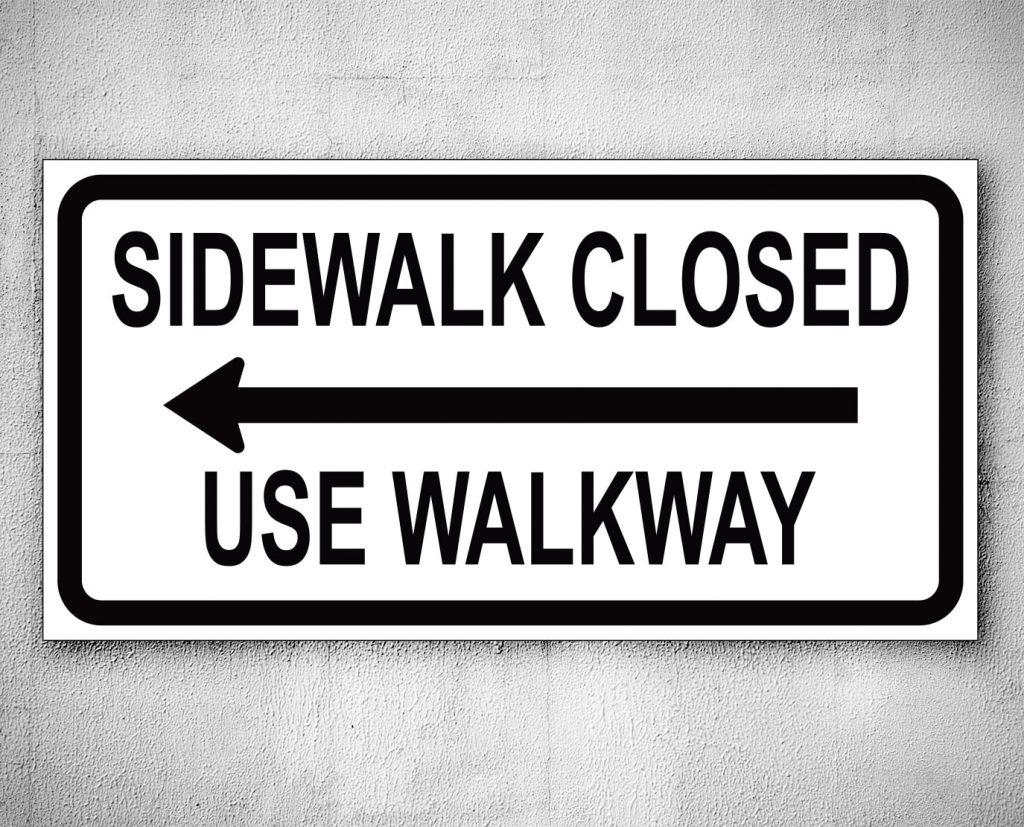 sidewalk closed arrow sign