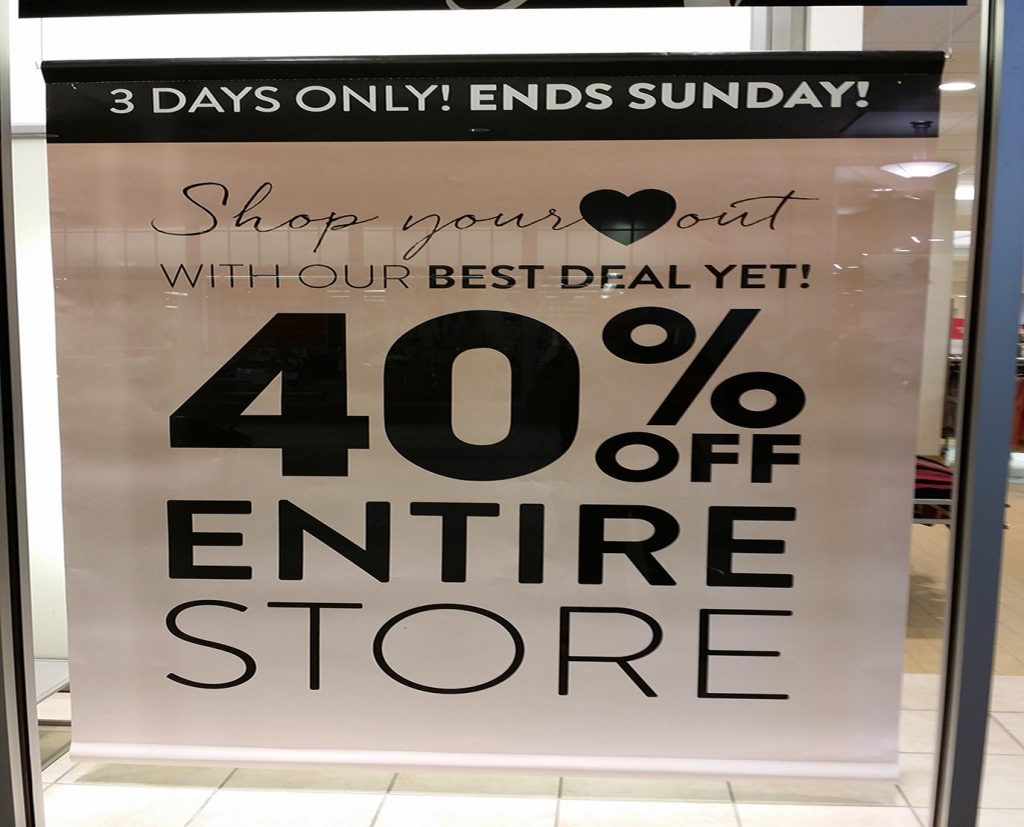 storefront window paper poster sign